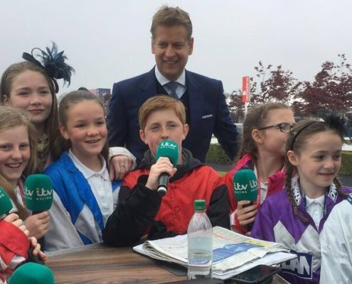 ITV's Ed Chamberlain getting some presenting tips from Hellsby Hillside pupils at Chester in May