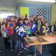Bryony Frost with a Racing to School group in the stewards' room at Wincanton