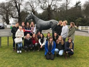Students standing next to the sculpture of Eclipse at Sandown