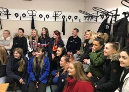 Pupils from Merrist Wood College listening intently in the company of champion jockey Richard Johnson